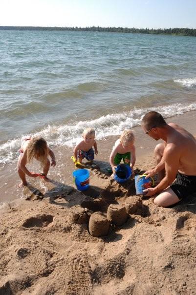Having fun at the beach at Kimball Lake, Meadow Lake Provincial Park